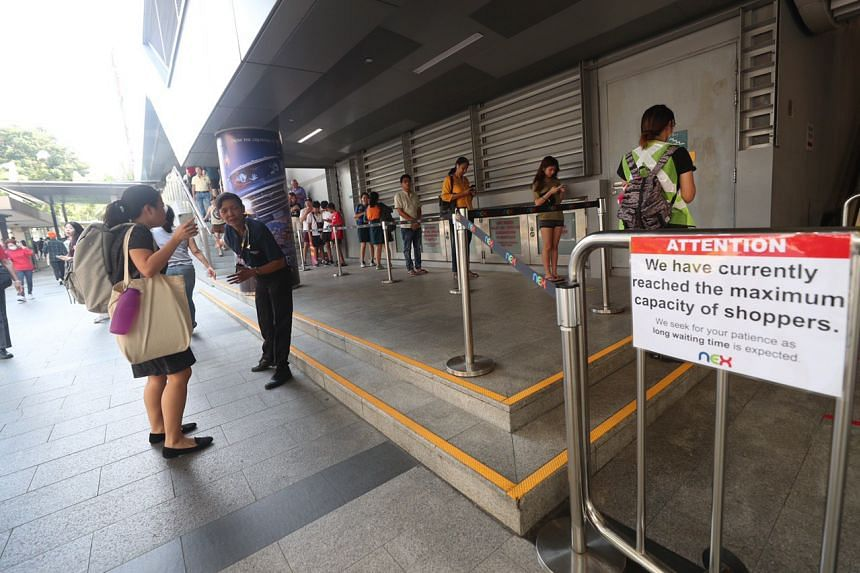 People queueing to enter Nex mall in Serangoon on March 27, 2020.