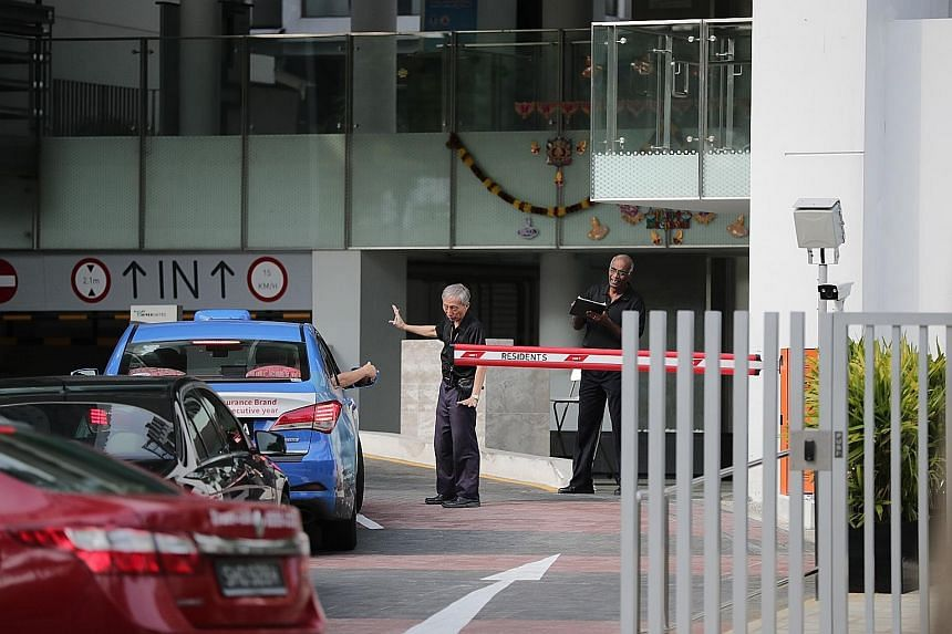 Security officers manning the entrance at Eight Riversuites condominium in November. Outrage was sparked last Deepavali, when a resident was caught on camera verbally abusing a security guard. ST FILE PHOTO