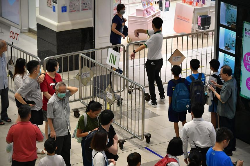 People queueing to enter Compass One mall in Sengkang on March 27, 2020.