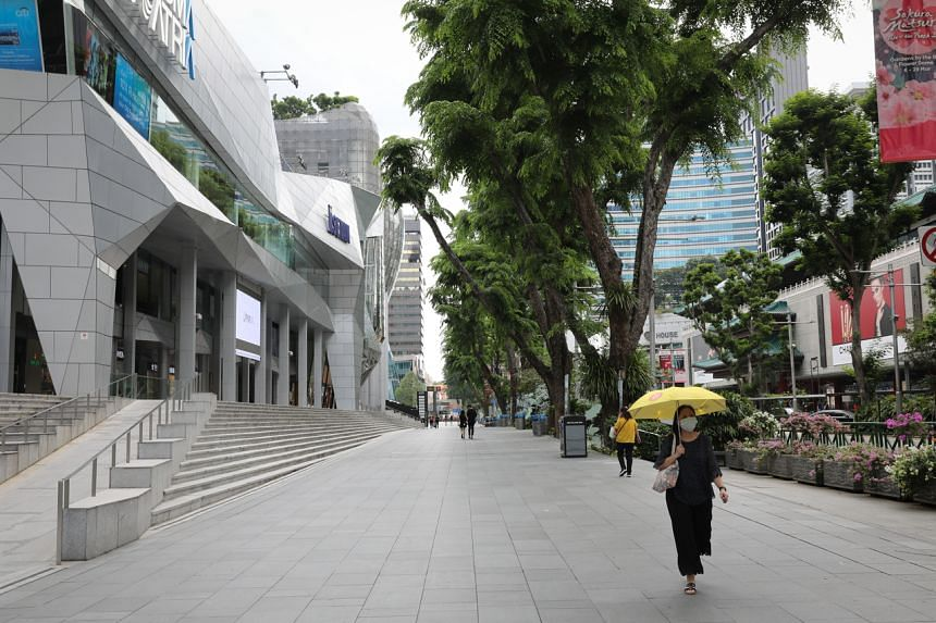 A relatively empty pedestrian path in front of Wisma Atria on March 26, 2020.