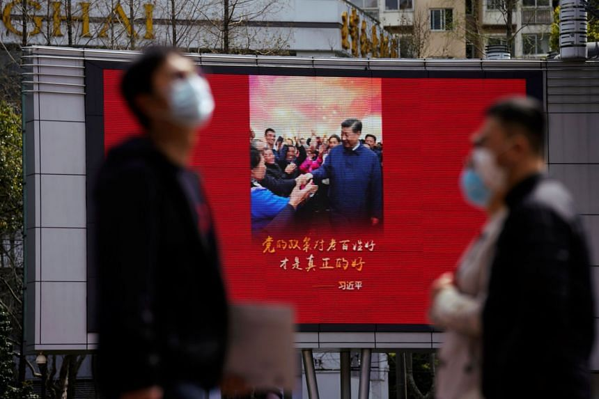 A big screen in Shanghai displaying an image of Chinese President Xi Jinping on Monday, after the Chinese city's emergency alert level was downgraded as the coronavirus situation improved. The number of infections in the United States has surged past