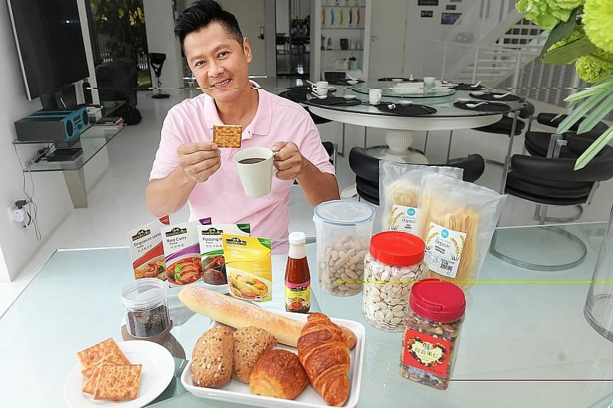 Actor Li Nanxing's (above) cabinets are packed with brown rice, organic noodles, sauces, canned food, spice mixes and his favourite snack: cream crackers.