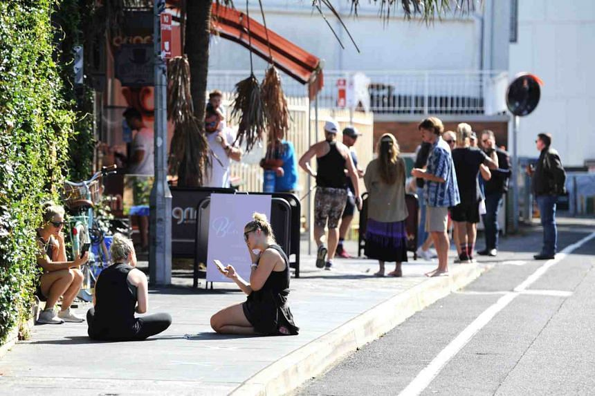 People practising social distancing at Cronulla Mall in Sydney, Australia, on March 28, 2020.