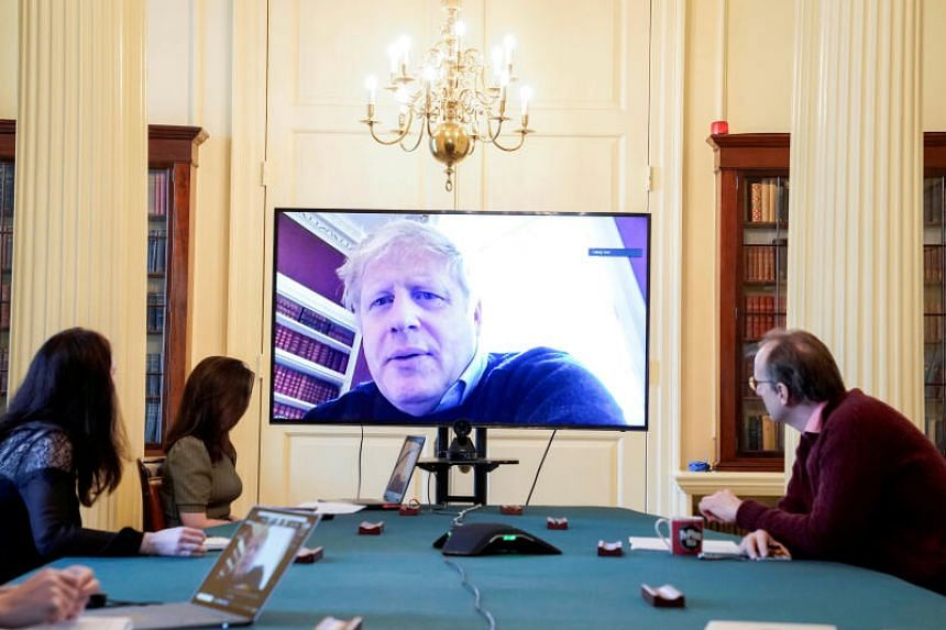 Britain's Prime Minister Boris Johnson chairing a meeting remotely as he self-isolates after testing positive for the coronavirus, in London on March 28, 2020.