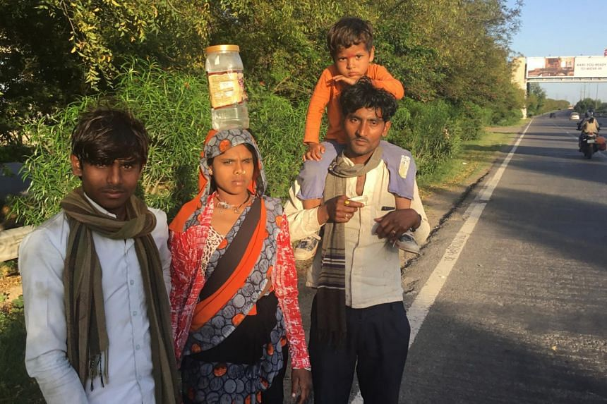 Mr Vijay Singh and his family on their way back home, nearly 500 kilometres away, on March 28, 2020.