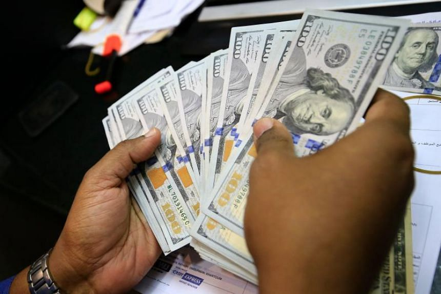 The dollar dipped 0.87 per cent against a basket of currencies on March 27 to 98.41. It fell 3.90 per cent last week - its biggest weekly decline since March 2009.