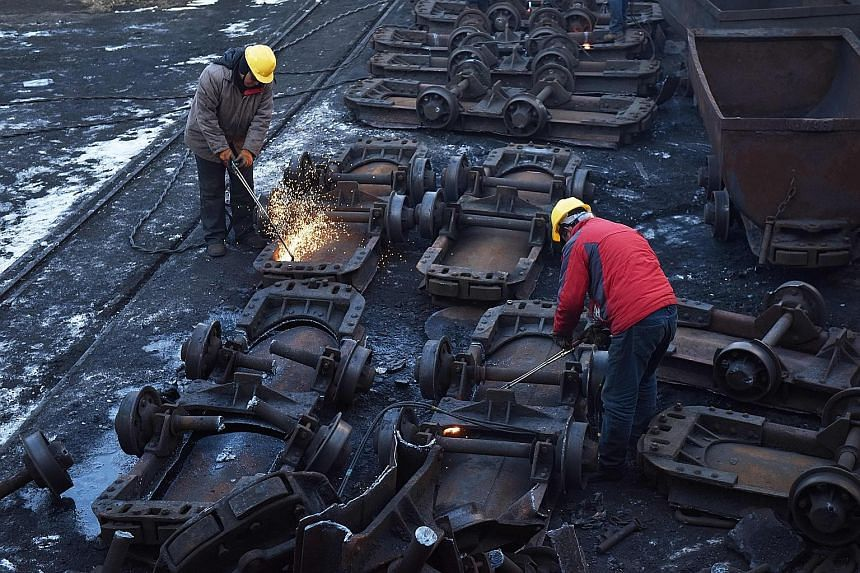 Workers cutting up coal carts at the Datai coal mine in Mentougou, west of Beijing, last December. With many investors adopting a wait-and-see attitude amid the coronavirus pandemic and the roll-out of relief packages, some are placing their bets on