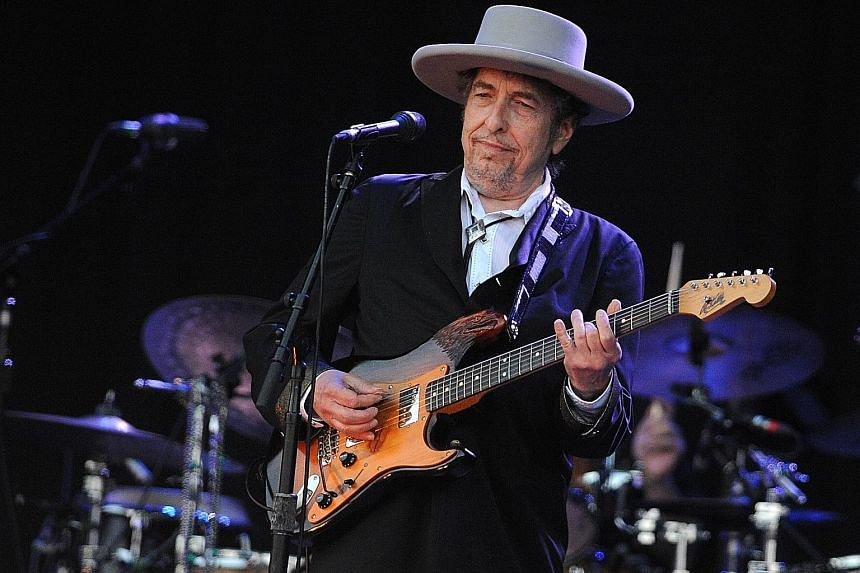 A file picture of Bob Dylan performing at a music festival in France in 2012. Last Friday, he released Murder Most Foul, a 17-minute ballad about the assassination of former United States president John F. Kennedy in 1963.