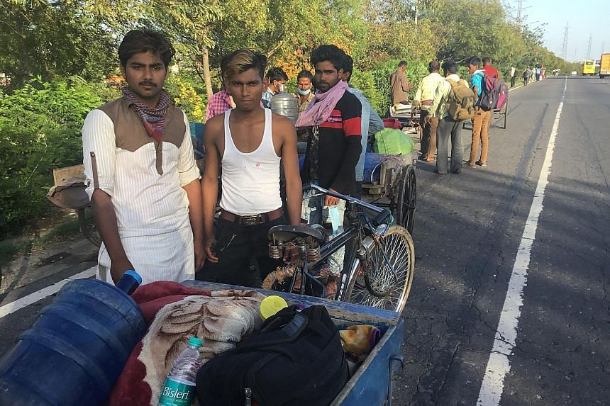 Mr Mohammed Riyaz, 19, (in sleeveless shirt) and his friends on their journey home last Saturday. They were travelling a distance of more than a thousand kilometres between Delhi and their home in Bihar's Supaul district after the Indian government i