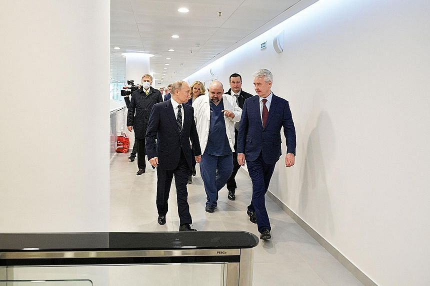 Russian President Vladimir Putin (front, left) and Moscow Mayor Sergei Sobyanin (right) visiting a hospital where Covid-19 patients are being treated in Moscow last week. This year's edition of Victory Day has been planned as one of the biggest celeb