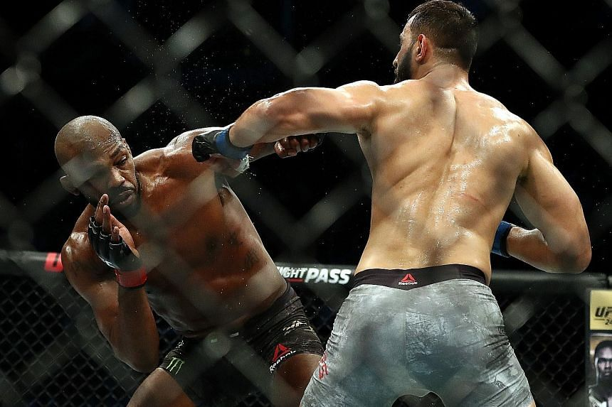 Jon Jones (left) dodging Dominick Reyes' punch during their UFC 247 light heavyweight bout in Houston last month.