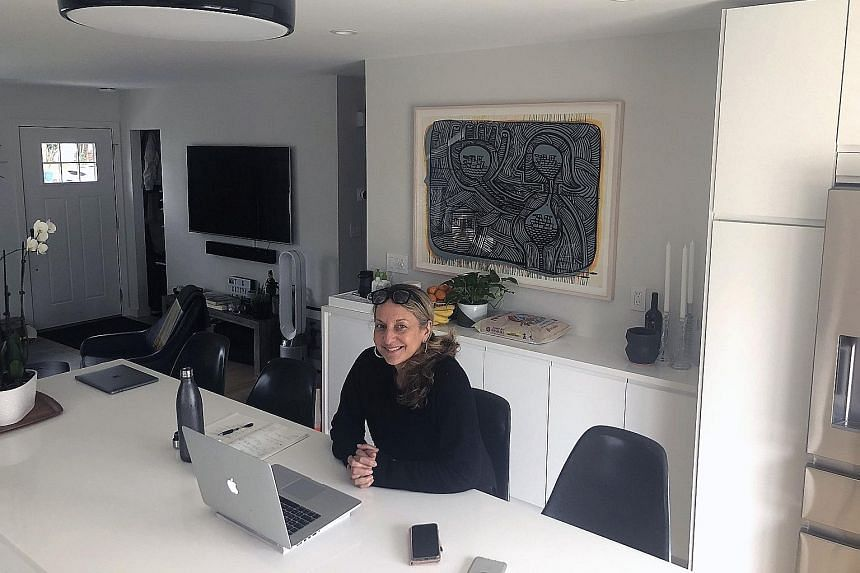 Regional sales manager Catherine Minervini holds her video-chats in her kitchen in her New Jersey home.