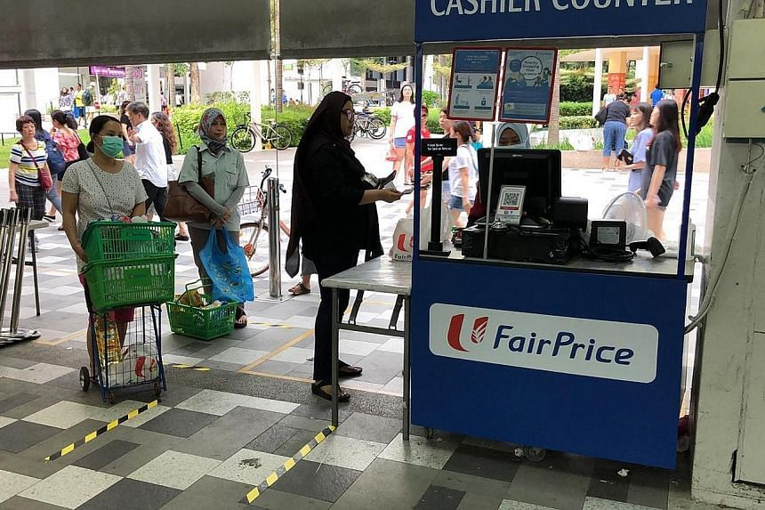 FairPrice is looking at hiring more workers and opening pop-up stores, like this one (above) near its Bedok North store, around the island in the next few days in spaces attached to existing stores. PHOTO: SEAH KIAN PENG