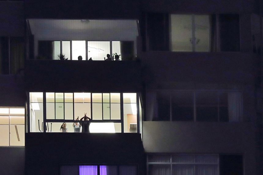 Residents of a condominium in Cairnhill applauding in appreciation of Covid-19 front-line workers on March 30, 2020.