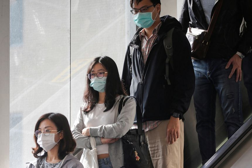 Commuters are seen wearing masks in Taipei on March 26, 2020. Taiwan has said the World Health Organisation ignored its questions at the start of the coronavirus outbreak.