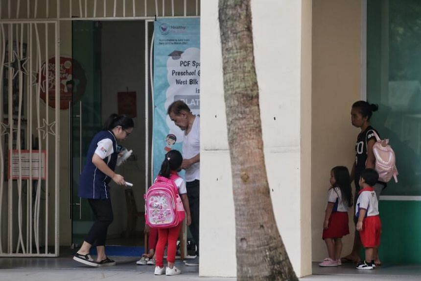 Pre-schoolers having their temperatures taken and adhering to social distancing measures at PCF Sparkletots Preschool @ Pasir Ris West Blk 650 on March 30, 2020.