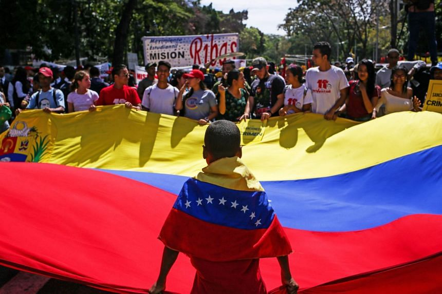 A photo taken on March 10, 2020, shows supporters of Venezuelan President Nicolas Maduro during a demonstration in Caracas.