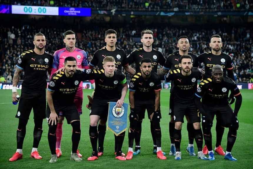 In a photo from Feb 26, 2020, Manchester City's players pose before a UEFA Champions League match against Real Madrid at the Santiago Bernabeu stadium in Madrid.