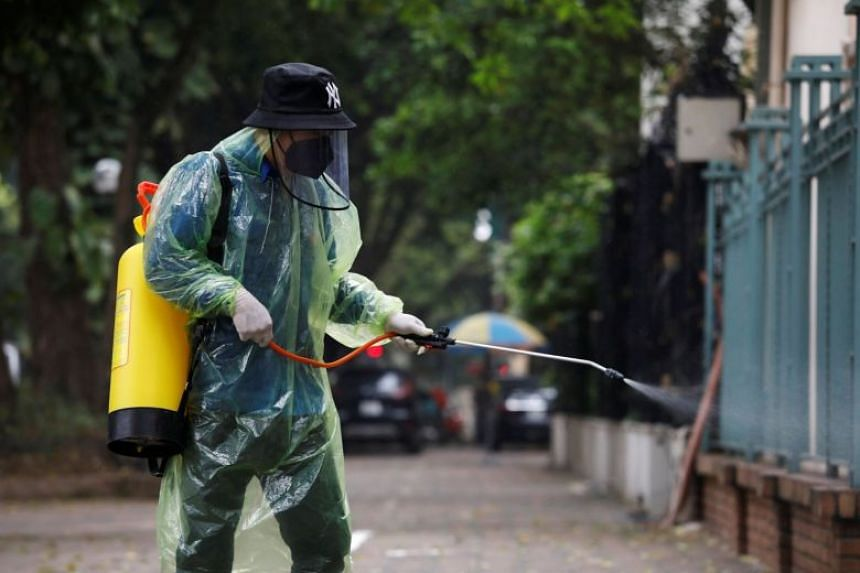 A worker disinfects a street in Hanoi on March 29, 2020.