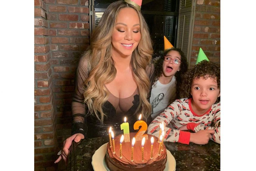 """""""ETERNALLY 12"""": American singer Mariah Carey may have turned 50 last Friday, but she is still young at heart. The singer posted on Instagram a photo of herself with a birthday cake and her 8½-year-old twins standing behind her. It was captioned: """"Sp"""