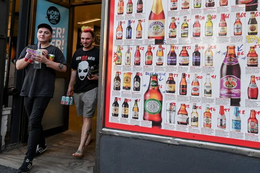 Major retailers agreed to enforce new rules limiting individual purchases as Australians went on a booze-buying spree amid a shutdown of non-essential services.