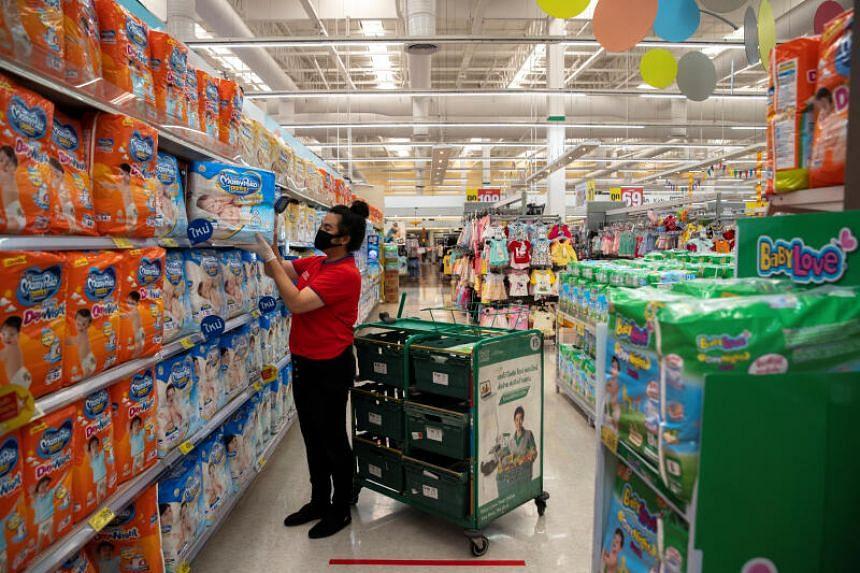 An employee of Tesco Lotus shop online preparing customers' orders in Bangkok on March 31, 2020.