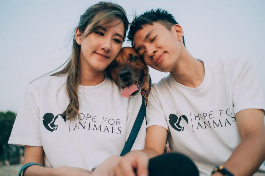 (From left) Hope For Animals founder Melodee Tan with her dog Loki and husband and core teammate Dominic Neo.