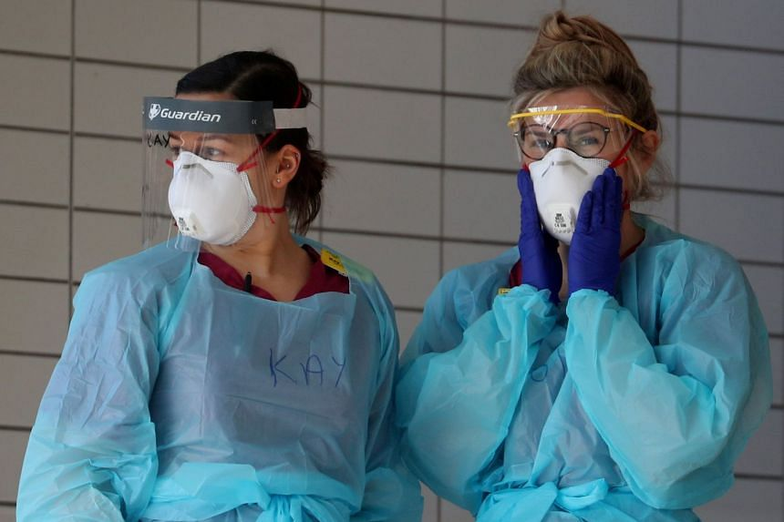 Medical staff wearing protective clothing at St Thomas' Hospital in London, Britain, March 31, 2020.
