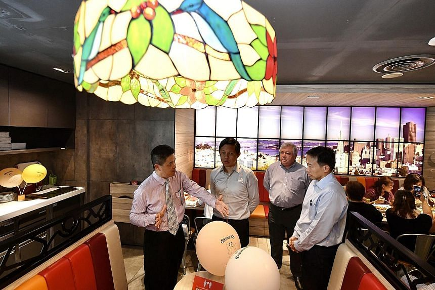 Trade and Industry Minister Chan Chun Sing visiting a Swensen's outlet at Bugis Junction yesterday with (from left) Mr Benny Ng, general manager of operations at ABR Holdings, the parent company of Swensen's; Mr Keith Chua, executive chairman of ABR