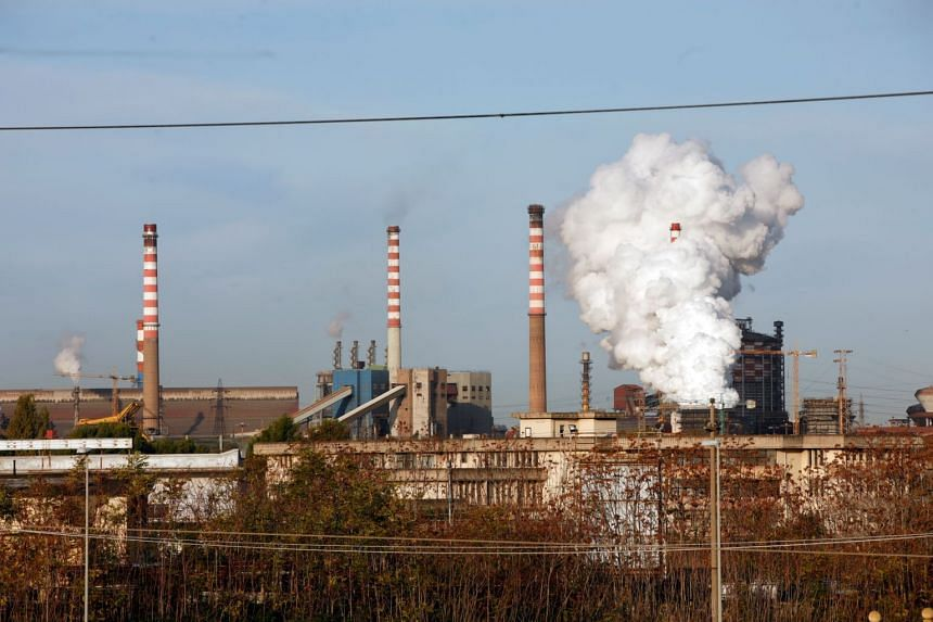 Steam comes out of the chimneys of the Ilva steel plant in Taranto, Italy, on Nov 11, 2019.