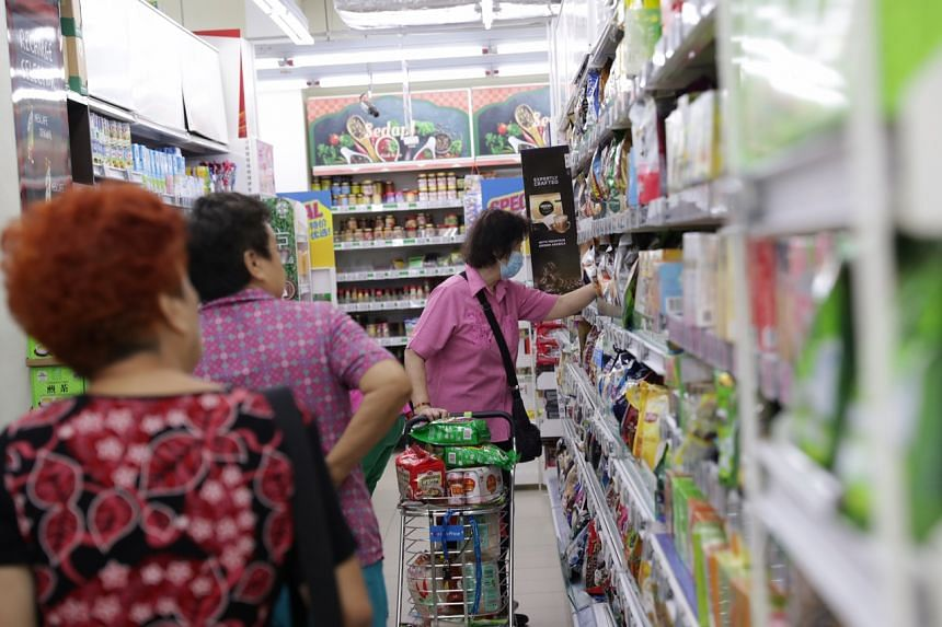 Shoppers during the Priority Shopping Hour at a Fairprice outlet in Bedok on March 30, 2020.