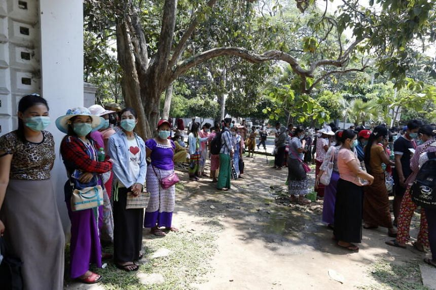 Garment workers whose factories were recently shut down in Yangon on March 30, 2020.