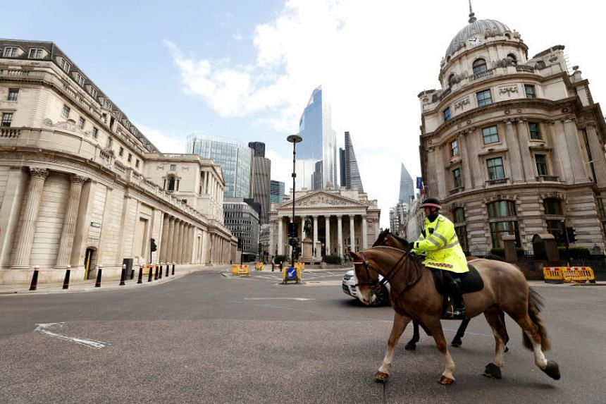 Police on horses patrol outside the Bank of England in London, on March 31, 2020.