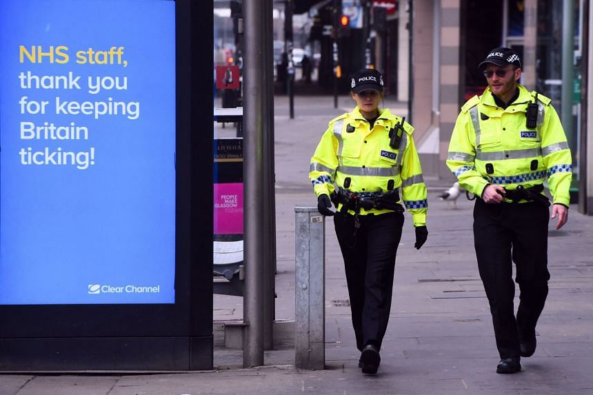 Police officers patrol in a Glasgow city centre street on March 27, 2020.