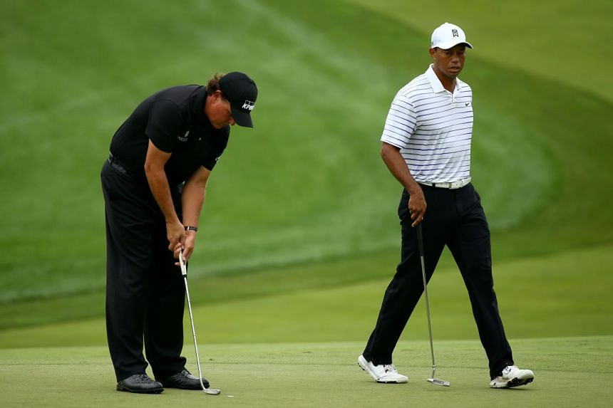 Mickelson (left) and Woods play in the PGA Championship in 2014.