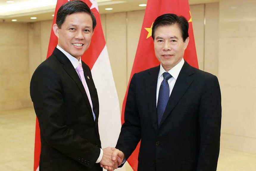 Trade and Industry Minister Chan Chun Sing with Chinese Minister for Commerce Zhong Shan in Beijing in August 2019.