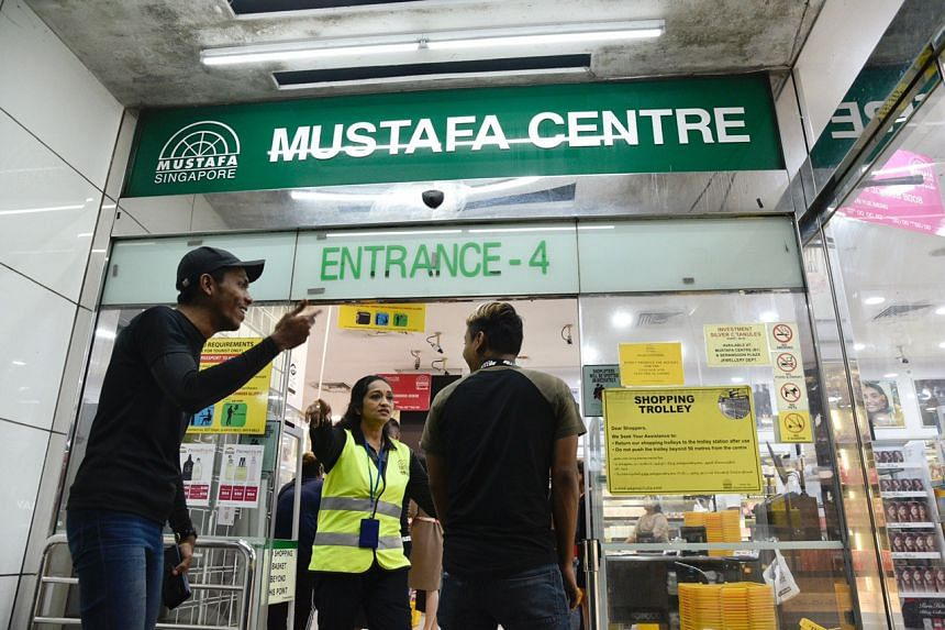Staff informs shoppers that Mustafa Centre will close at 11.30pm on April 2, 2020.