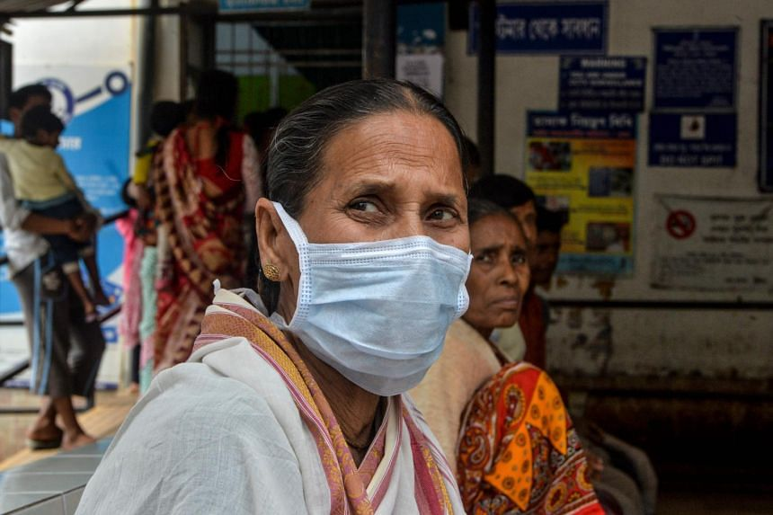 An elderly woman at an awareness event about the coronavirus at a hospital in Siliguri, India, on Feb 21, 2020.