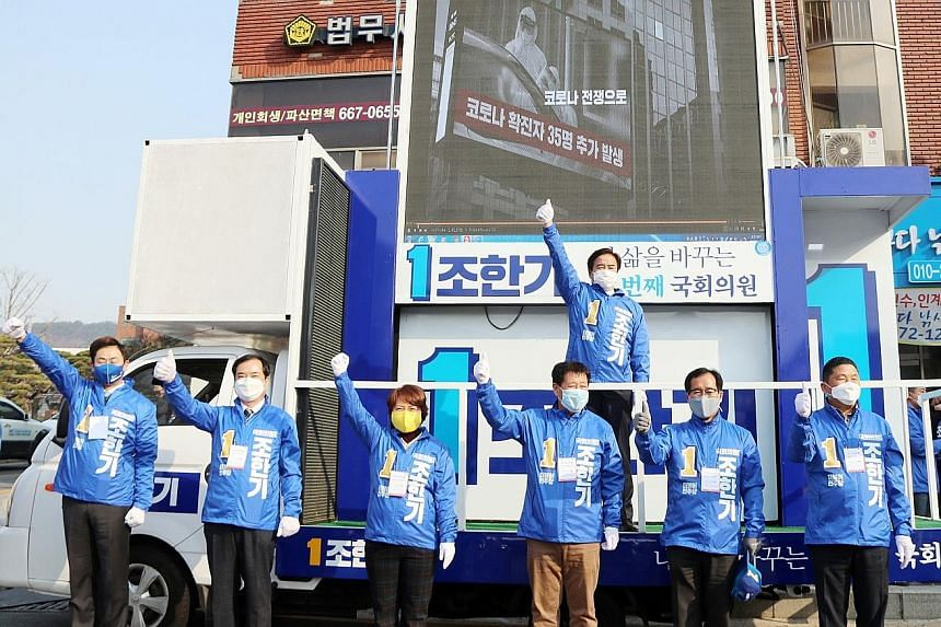 Campaigners for Mr Cho Han-ki of South Korea's ruling Democratic Party seeking citizens' support at a square in Seosan, South Korea, yesterday. PHOTO: EPA-EFE