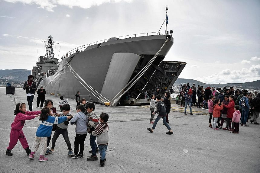 A military carrier used to carry refugees and migrants docked at the Greek island of Lesbos on March 7. The European Court of Justice has found that Poland, Hungary and the Czech Republic failed to fulfil their obligations to take in migrants under E