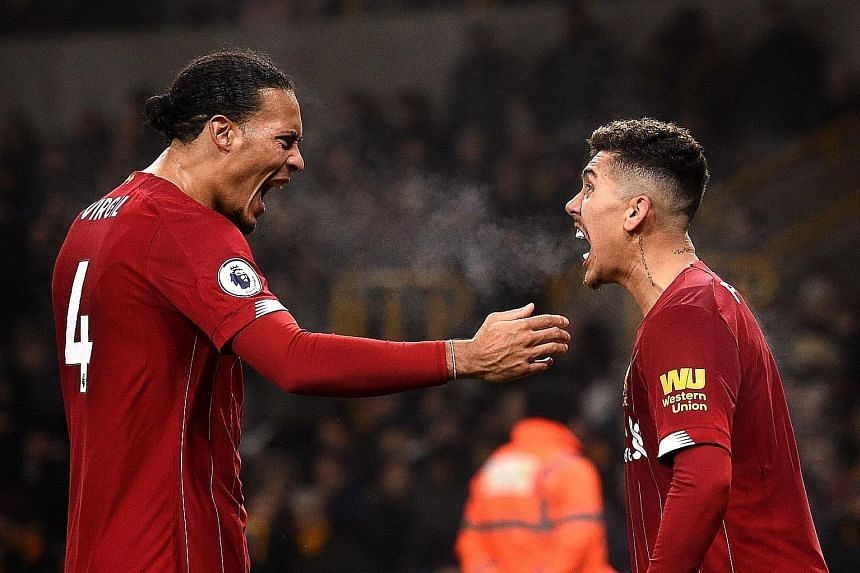 Defender Virgil van Dijk (left) and forward Roberto Firmino are key players of runaway Premier League leaders Liverpool. The Reds were well on course for their first English top-flight title since 1990 when the league was suspended owing to the coron
