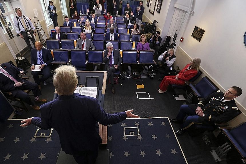 President Donald Trump addressing the media during a daily briefing on Covid-19, in the White House press briefing room on Wednesday. PHOTO: EPA-EFE Father Brian Mahoney hearing a parishioner's confession in the carpark of St Mary's Church in Chelmsf