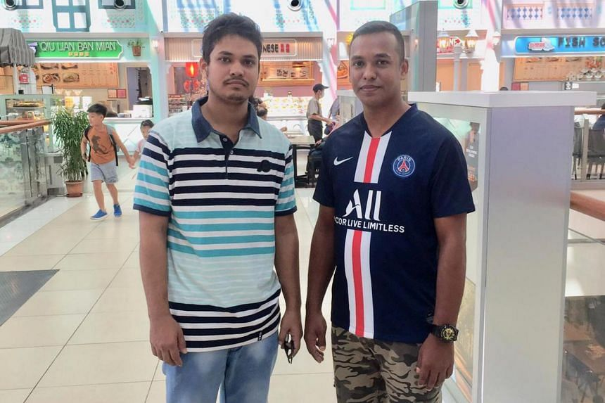 Mr Ahmed Amad (right) and his brother Mr Ahmed Jabed have not met up in the past few weeks as they believe it is socially responsible to stay at their respective in and not go out.