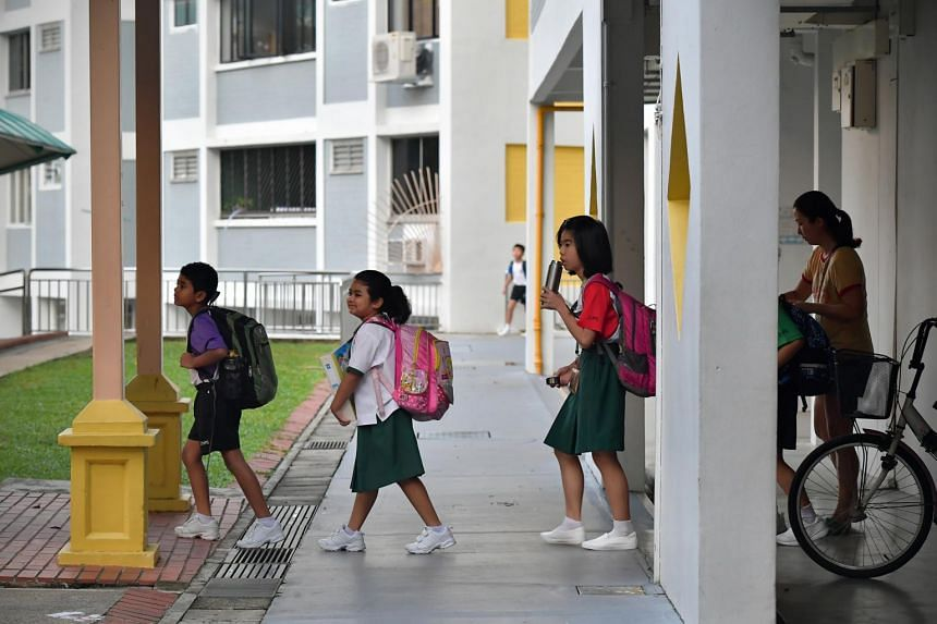 Students returning to Zhenghua Primary School on March 23, 2020.