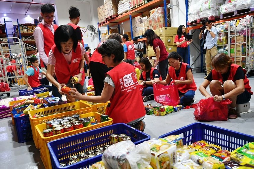 A photo taken on Feb 20, 2020, shows volunteers helping to sort and pack items at Food from the Heart at its Joo Seng Road warehouse.