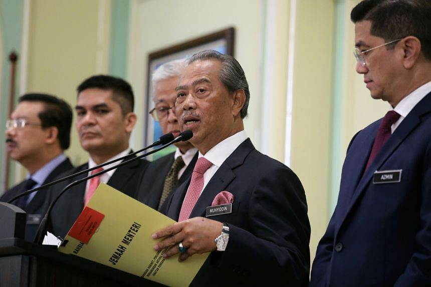 Malaysian Prime Minister Muhyiddin Yassin during a news conference on March 11, 2020.