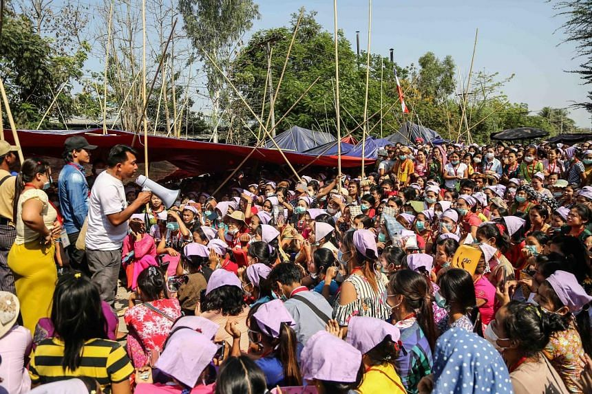 Garment factory workers in Yangon rallying last week to get their jobs back after losing them amid the coronavirus outbreak, which has led to a collapse in demand from Western fashion firms. PHOTO: REUTERS