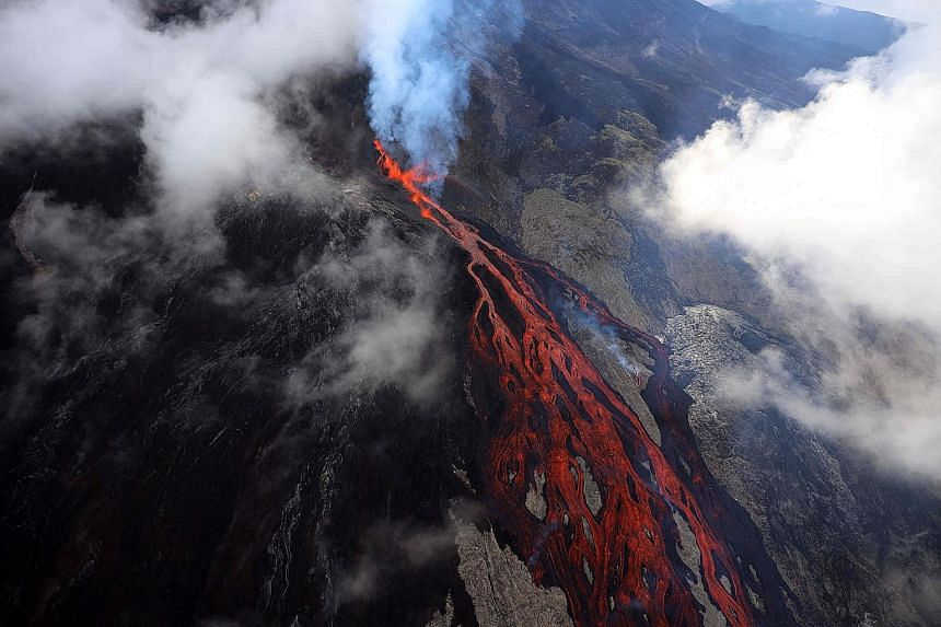 Lava oozing down the Piton de le Fournaise volcano during an eruption on Thursday. The volcano on the French Indian Ocean island of La Reunion ranks among the world's most active and has erupted more than 150 times since the 17th century, according t