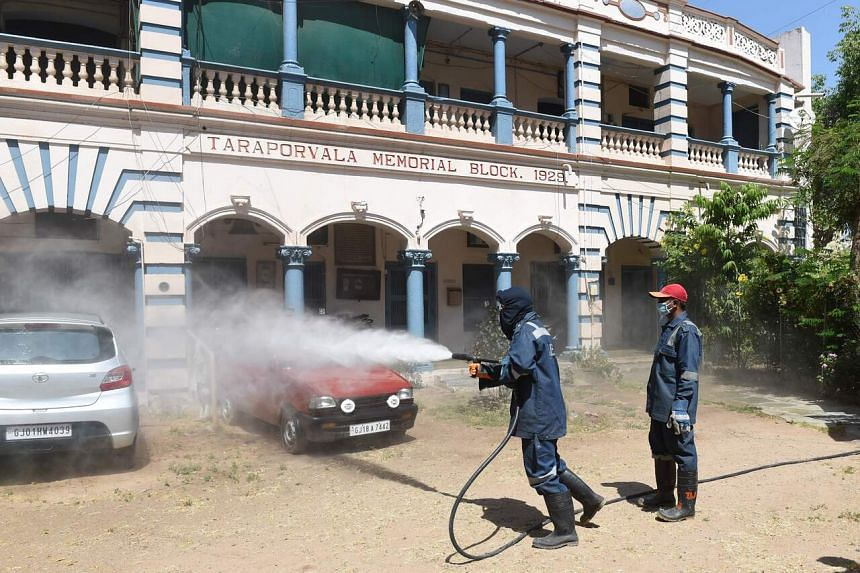 Firefighters spray disinfectant in a residential colony in Ahmedabad, on April 3, 2020.