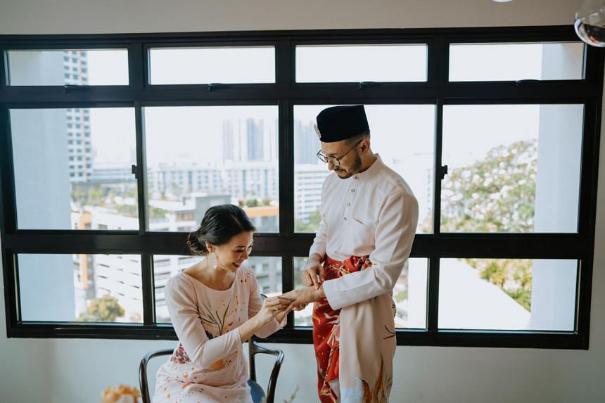 Mr Amin Sulaiman and Ms Noelle Yong got hitched in their Housing Board flat with only family members present.